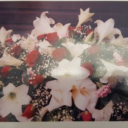 Coffin spray lillies and roses 4ft from £150. 5ft from £175