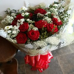 12 beautiful red roses with foliage and gyp £45