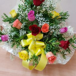 12 mixed coloured roses arranged in a box £ 25