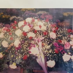 Coffin spray approx 4ft mixed seasonal flowers from £95