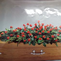 Coffin spray of all roses 4ft from £150. 5ft from £195