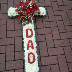 Cross 2ft £60. 3ft £75 4ft £85. 5ft £115. Cross with name in flowers 4ft £95. 5ft £125